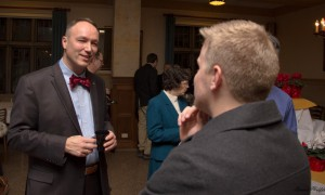 Dr. Hulsmann chats with a student post-lecture
