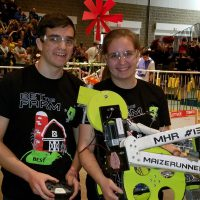 Elsie Becker and her brother Dirk holding their robot.