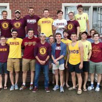 The Tri-Rhos pose together for a picture outside of Hopeman hall during their annual Homecoming cookout